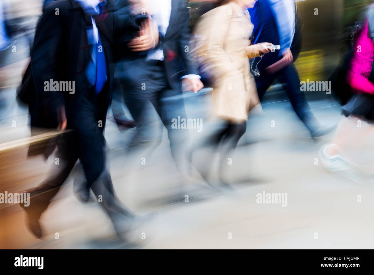 crowd of walking people in the city in motion blur - Stock Image