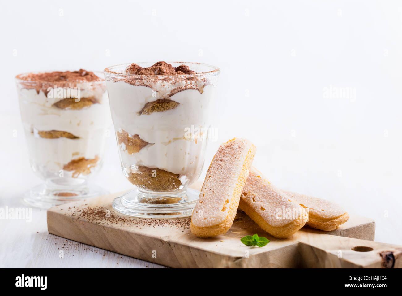 Homamade tiramisu, traditional Italian dessert in glass - Stock Image