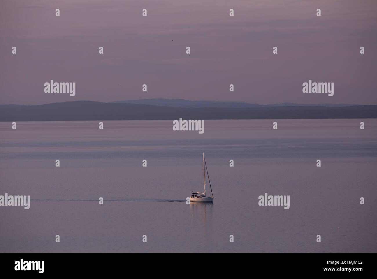 Sunset afterglow at dusk over Kvarner Gulf, Losinj, Croatia. - Stock Image