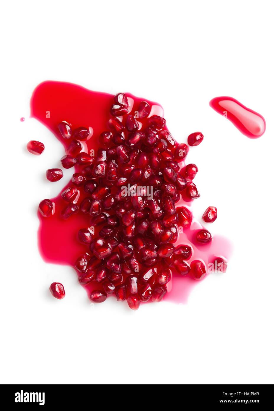 Pomegranates seeds on white background - Stock Image