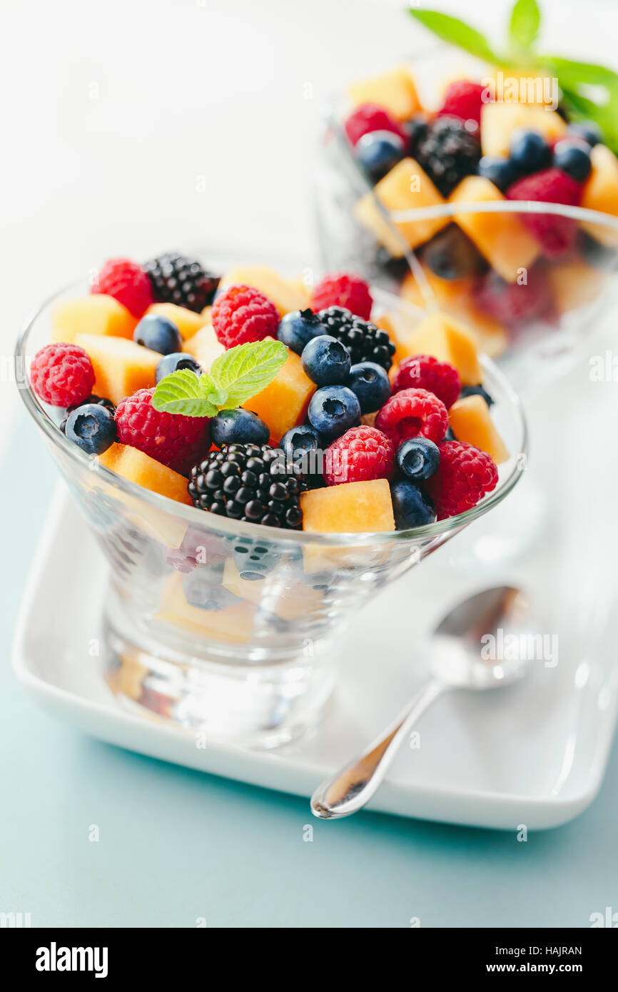 Mixed fruit salad in bowl - Stock Image
