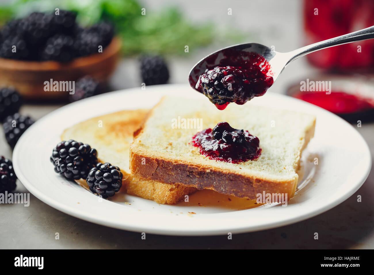 Toast with homemade blackberry jam - Stock Image