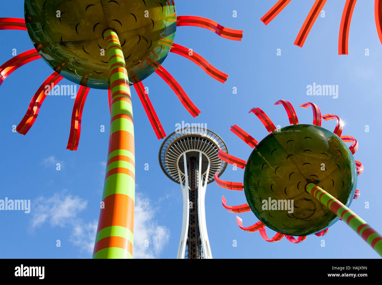 The view of a tower through artificial flowers in Seattle (Washington). - Stock Image