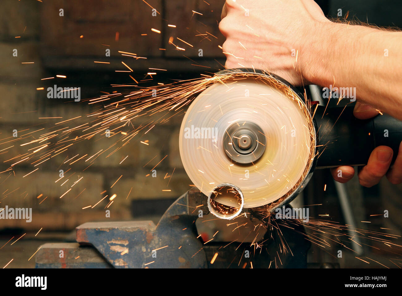 cutting metal with angle grinder, sparks from the disk - Stock Image