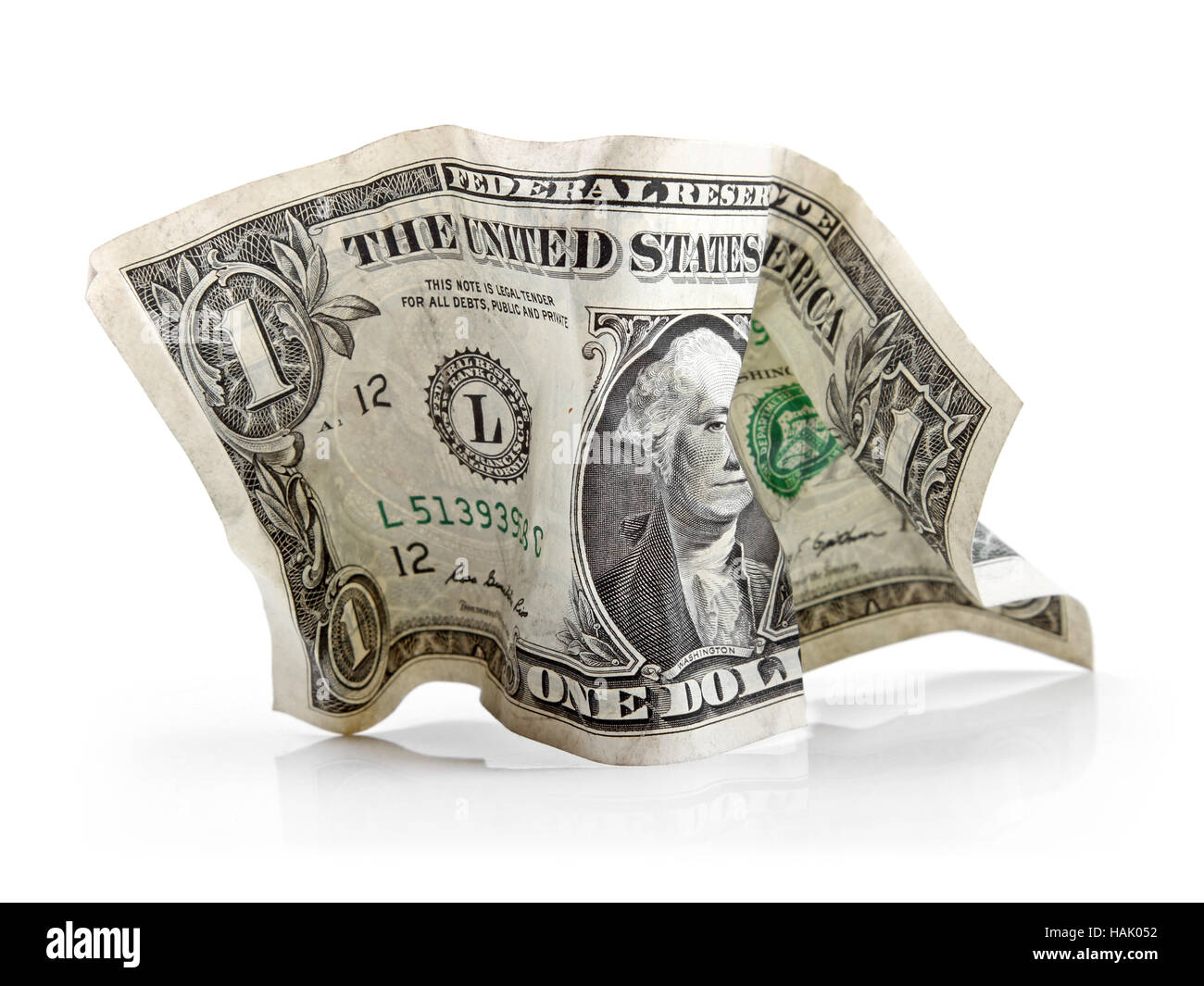 crumpled dollar bill isolated on white - Stock Image
