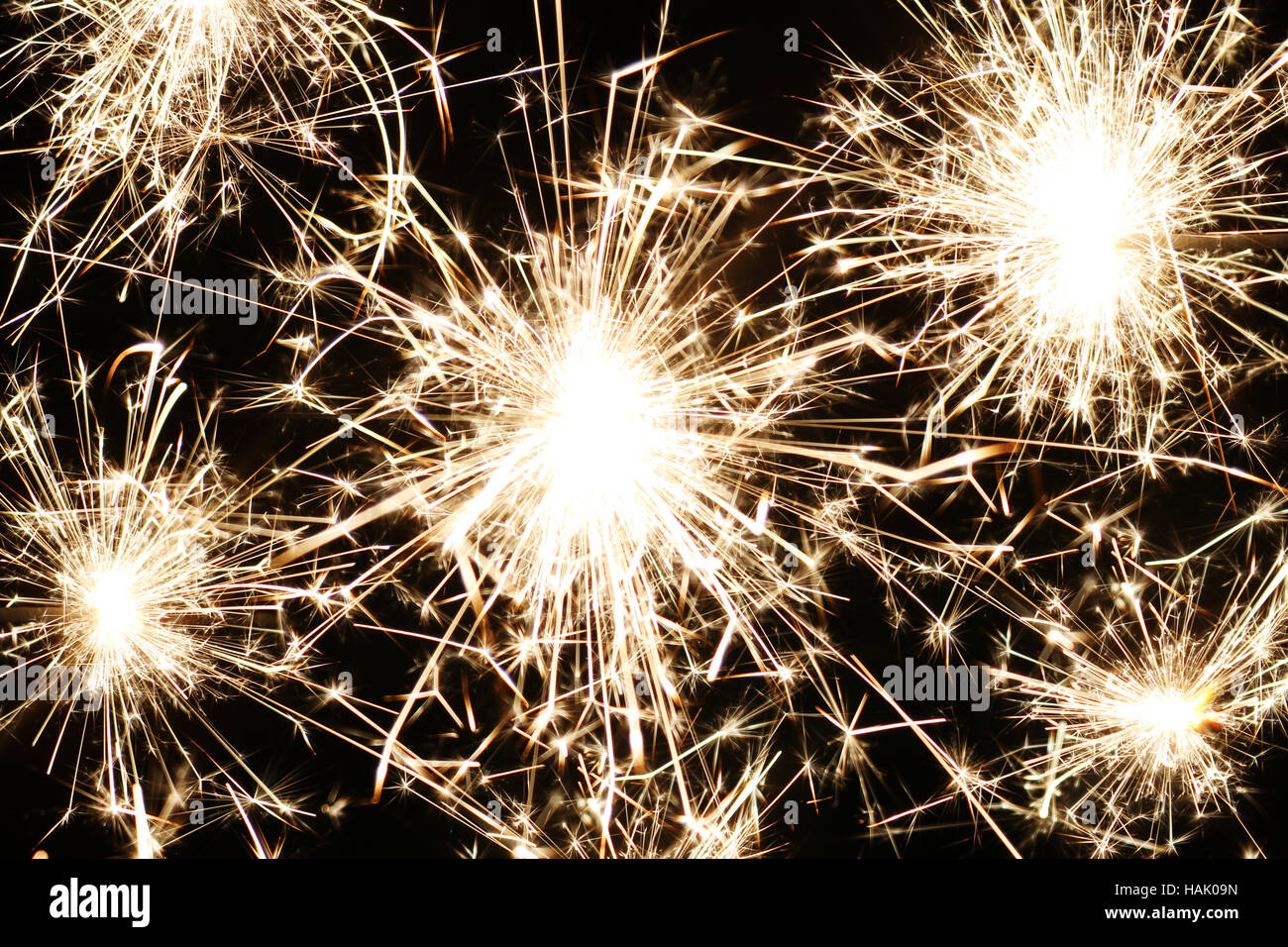 christmas and newyear party sparklers on black background - Stock Image