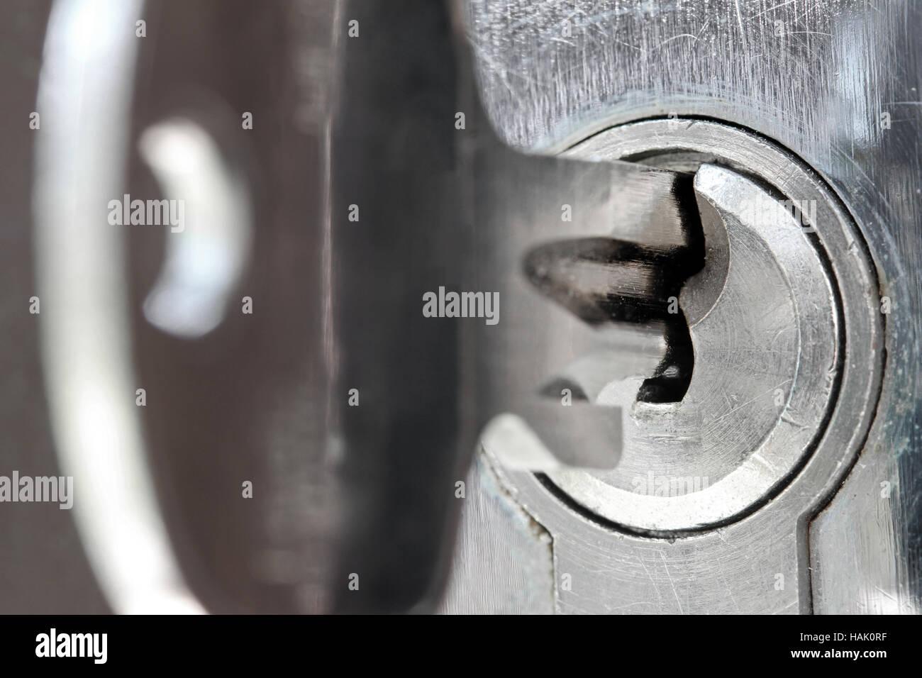 door lock and key black and white. Macro Shot Of Door Lock Keyhole With Key And Black White F