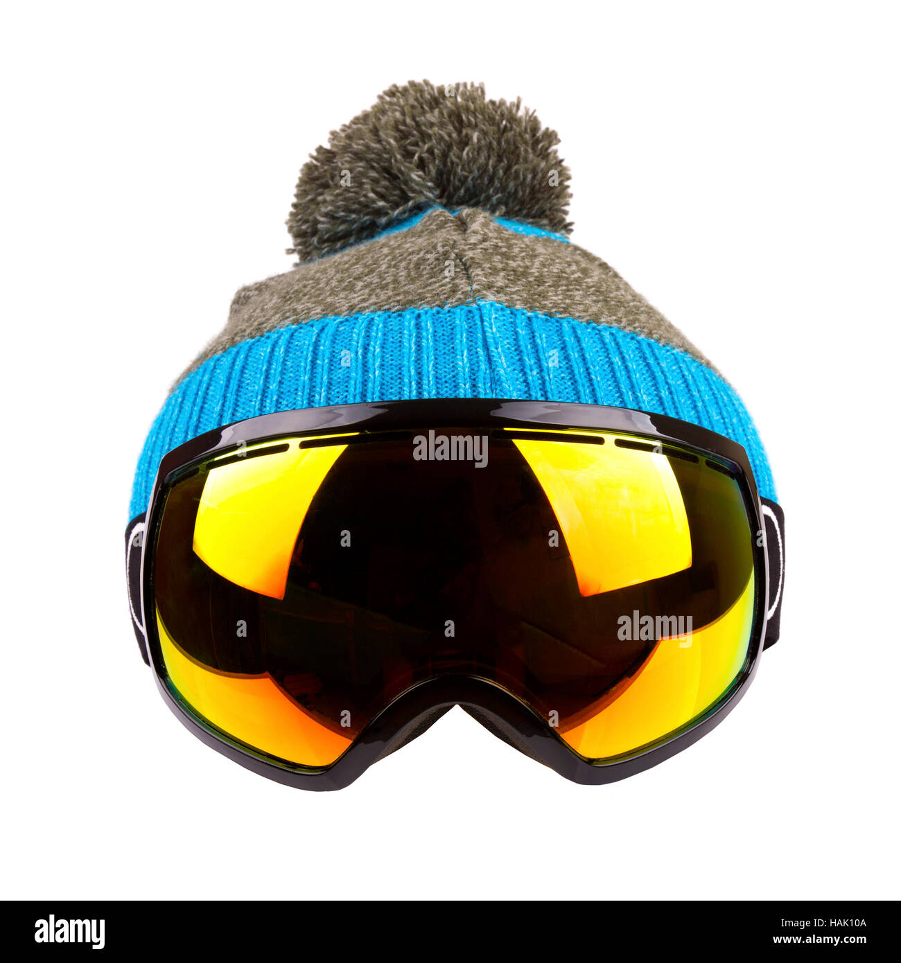 ski goggles and woolen hat isolated on white - Stock Image
