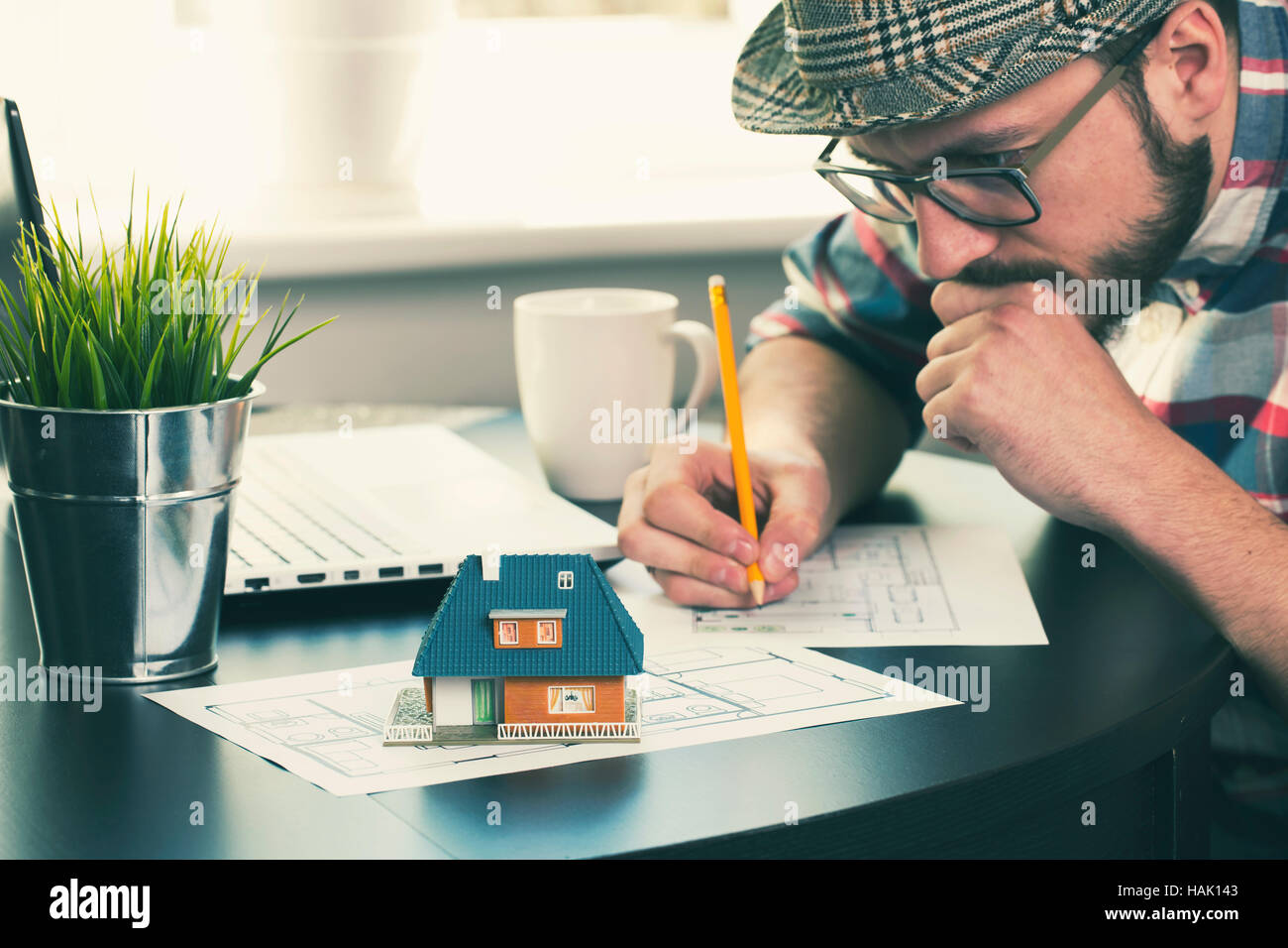 architect, construction engineer working on new house project at office - Stock Image
