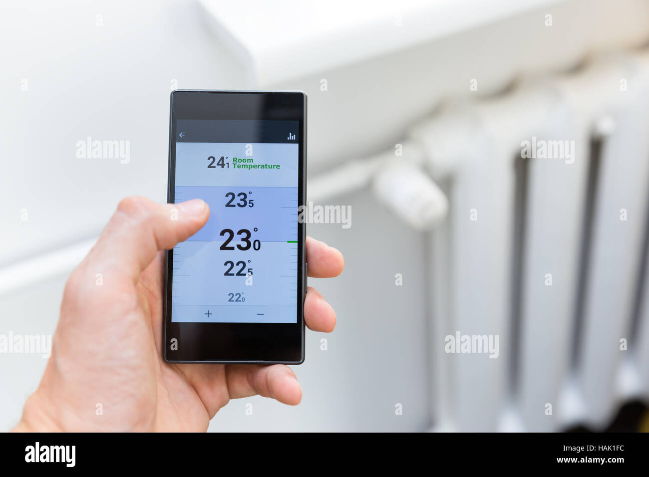 modern house heating temperature control system with smart phone - Stock Image