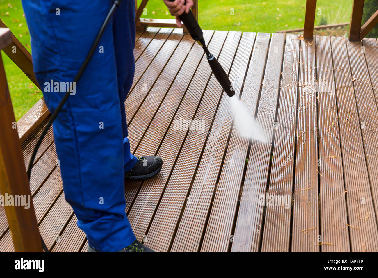 cleaning wooden terrace with high pressure washer - Stock Image