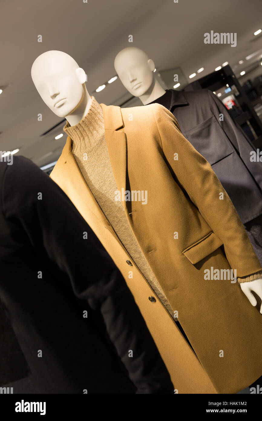 men's fashion - mannequins dressed in coats in a clothes store - Stock Image
