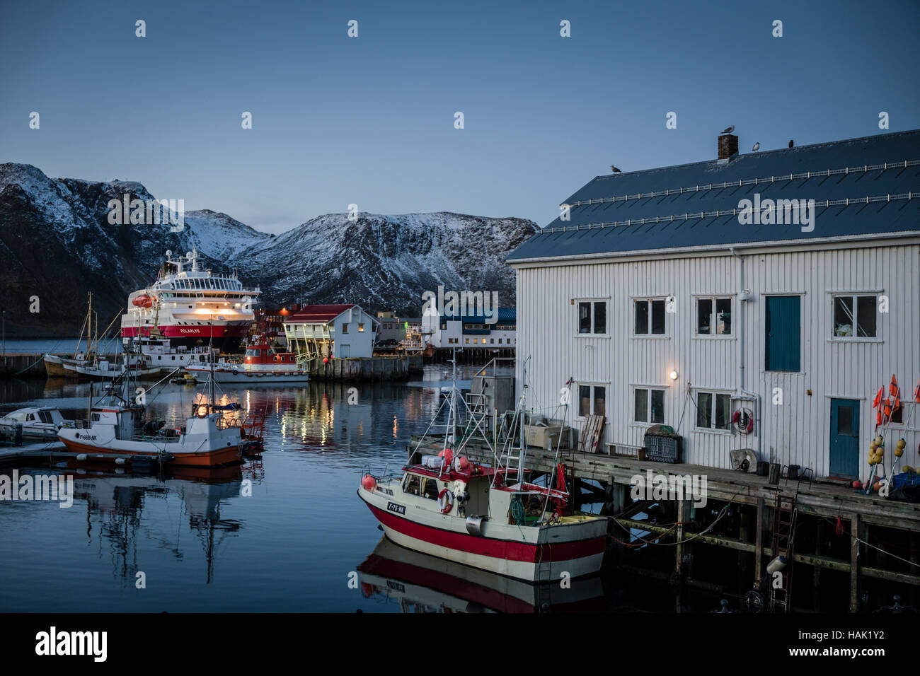 Hurtigruten docked in the  town of Honningsvag close to the North Cape in Arctic Norway. - Stock Image