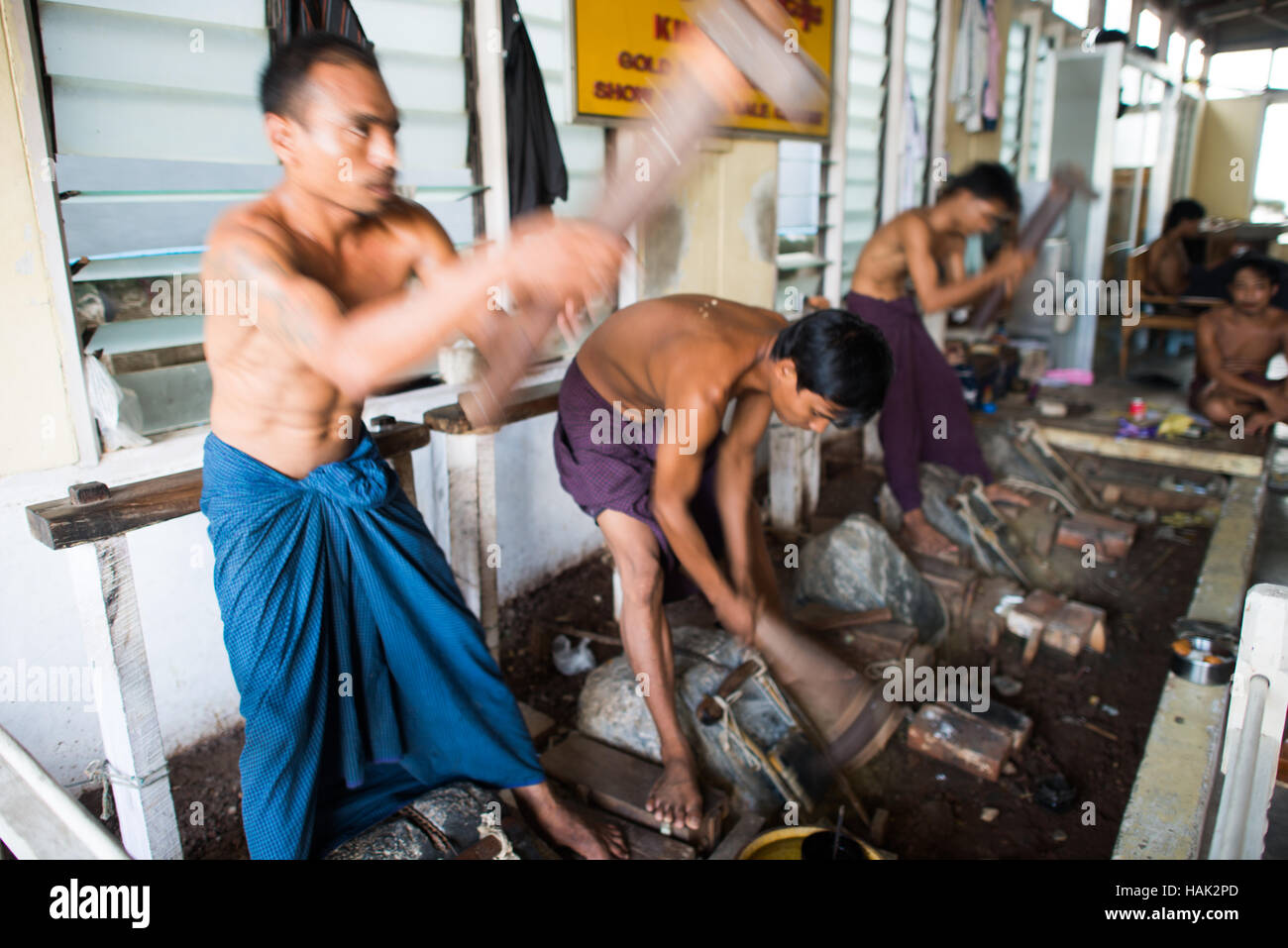 MANDALAY, Myanmar - MANDALAY, Myanmar - The manual process of pounding and packaging ultra-thin sheets of gold leaf - Stock Image