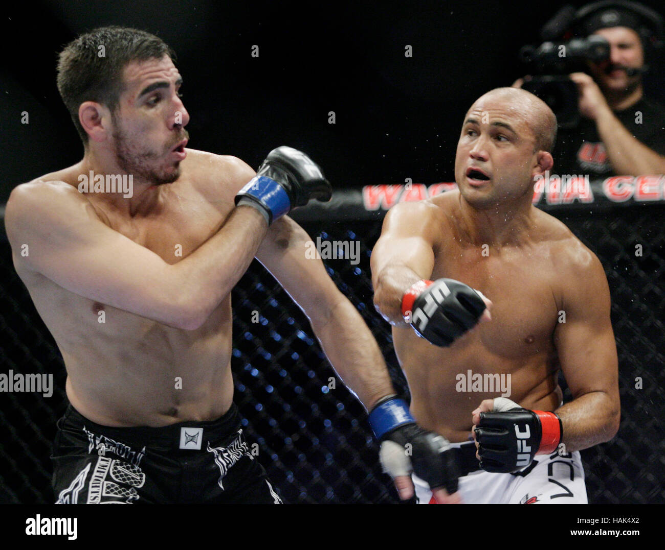 BJ Penn, right, fights Kenny Florian during UFC 101 at the ...