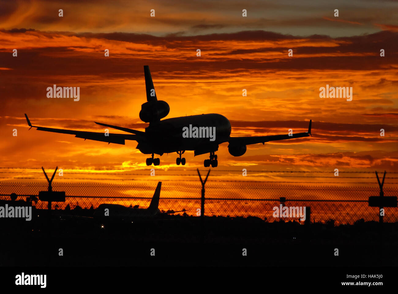Aeroplane landing LAX Los Angeles California Sunset - Stock Image