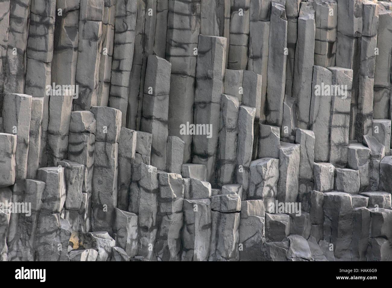 Hexagonal basalt columns, volcanic rock formations near the village Vík í Mýrdal, southern Iceland - Stock Image