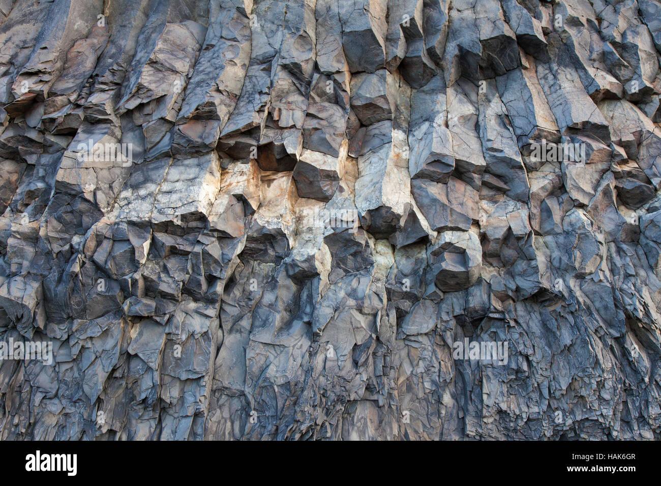 Hexagonal basalt columns, volcanic rock formations near the village Vík í Mýrdal, southern Iceland Stock Photo