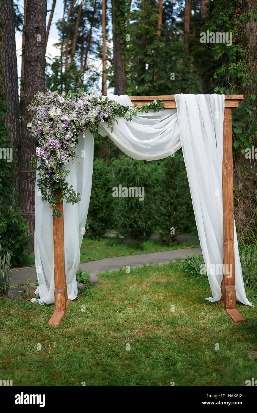 Beautiful wedding arch decorated with flowers in the park stock beautiful wedding arch decorated with flowers in the park junglespirit Gallery
