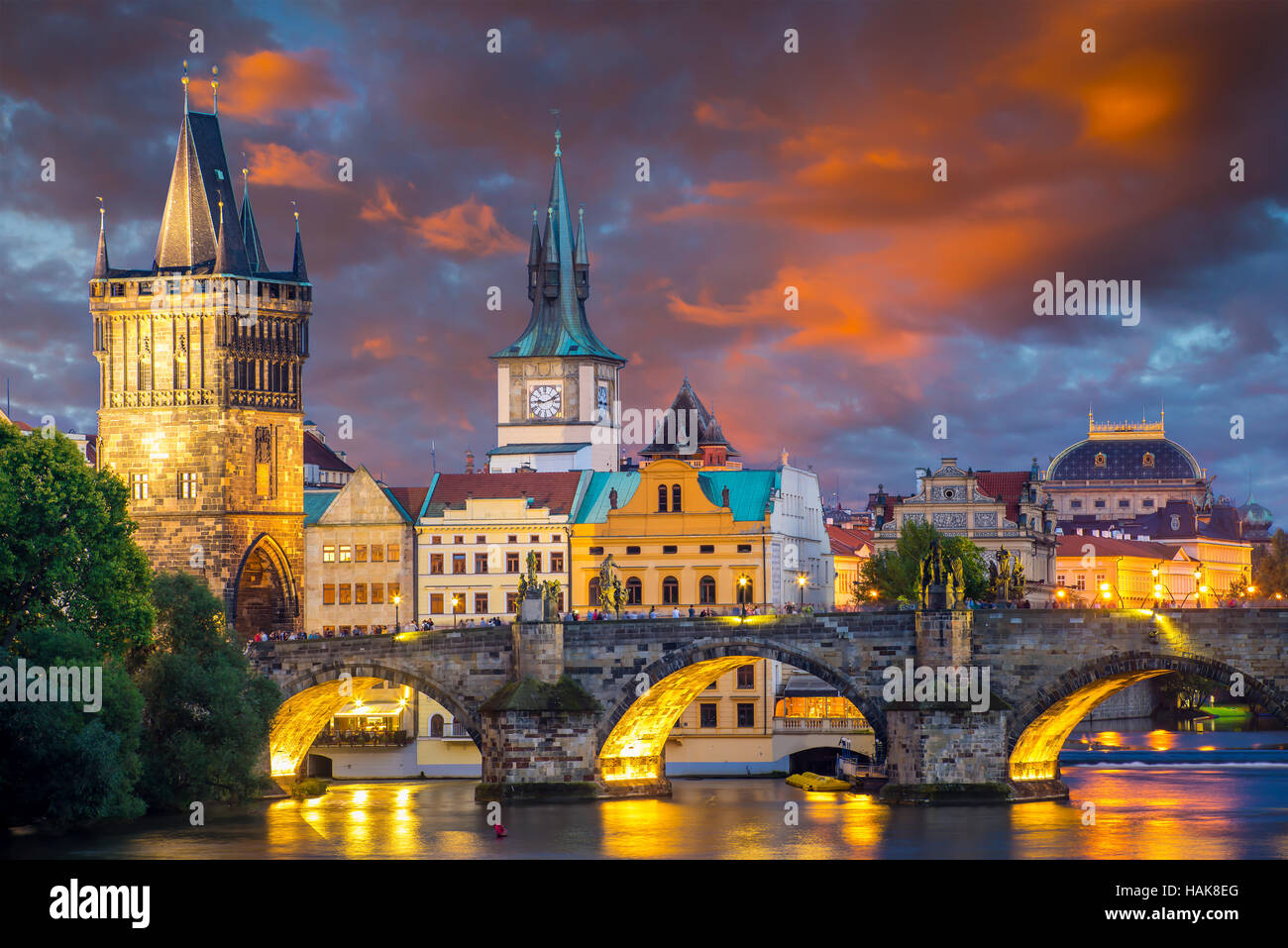 Vibrant stormy sunset sky over the River Vltava and Charles Bridge Prague Czech Republic Europe - Stock Image