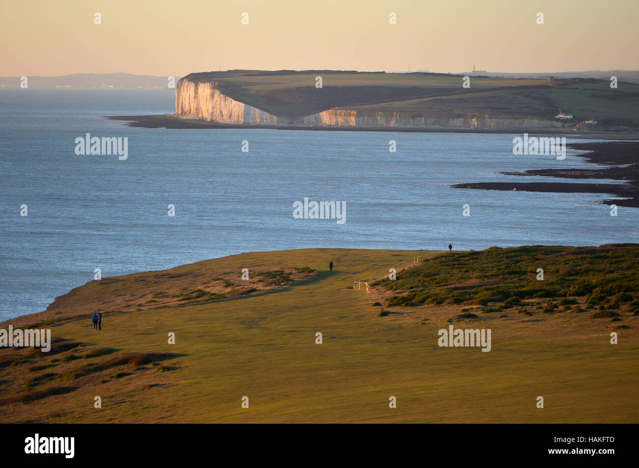 Chalk cliffs of the Seven Sisters where the South Downs meets the sea - Stock Image