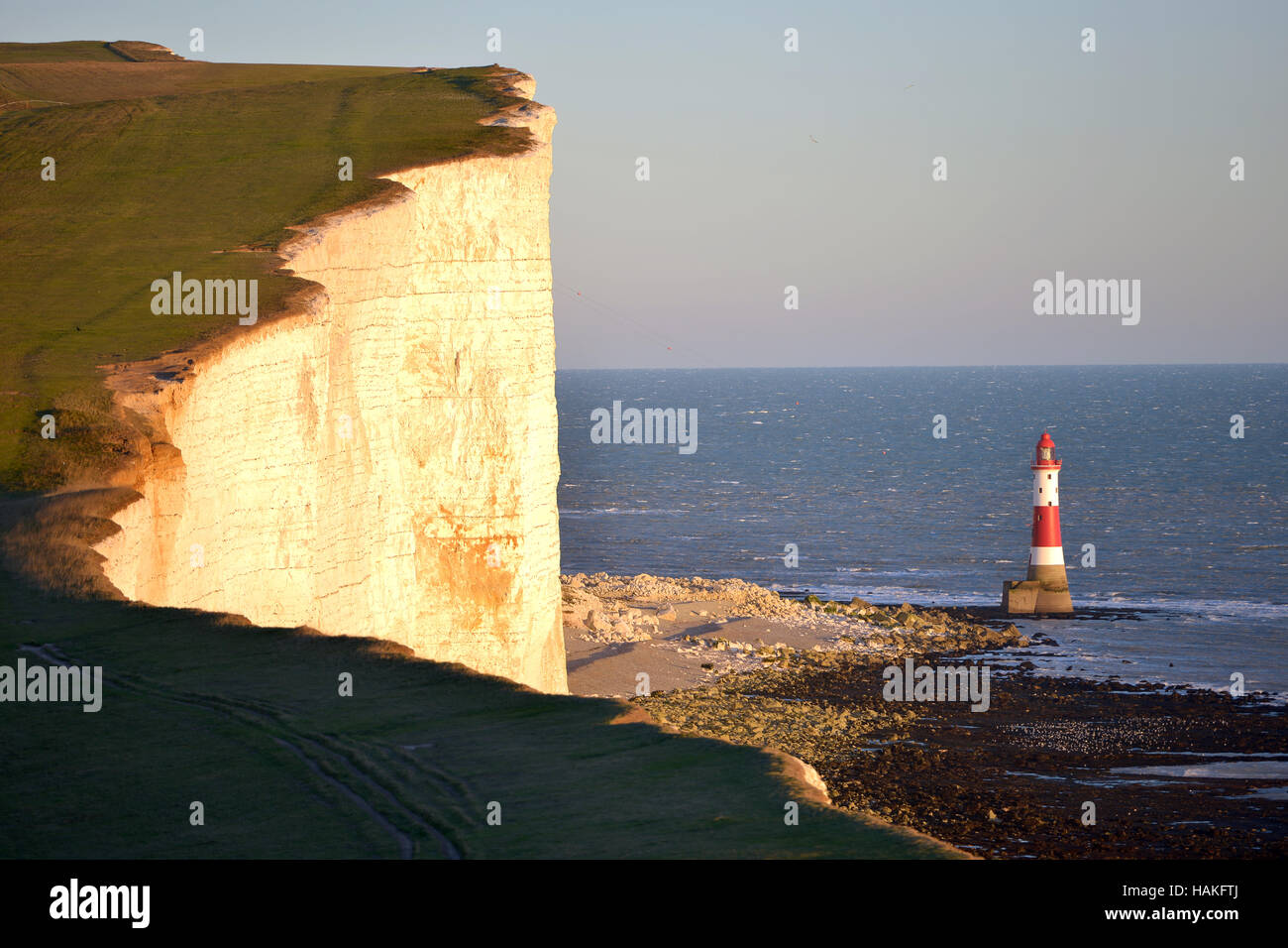 Beachy Head lighthouse at low tide - Stock Image