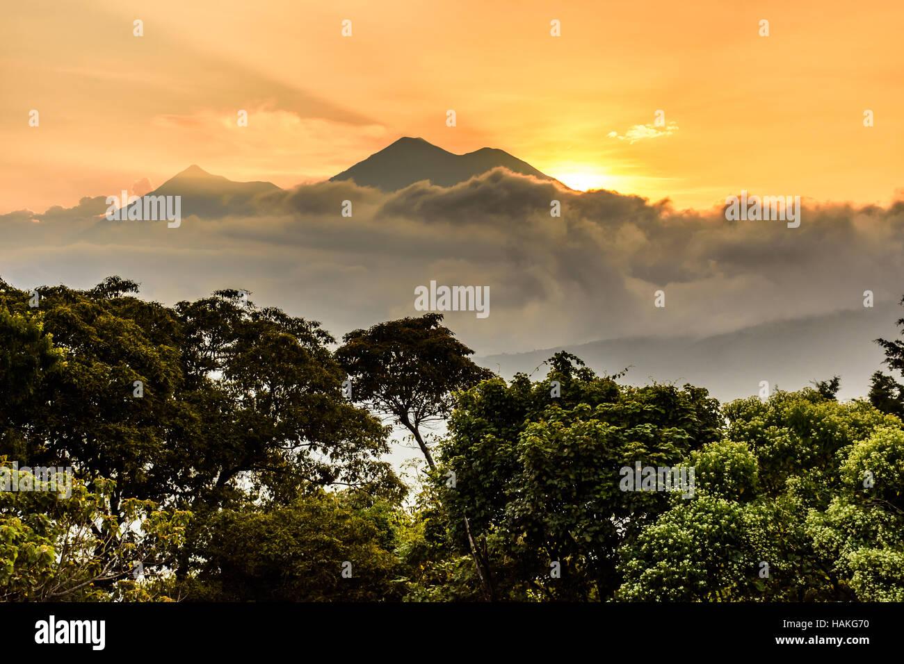 Fuego & Acatenango volcanoes at sunset outside UNESCO World Heritage Site of Antigua, Guatemala, Central America - Stock Image