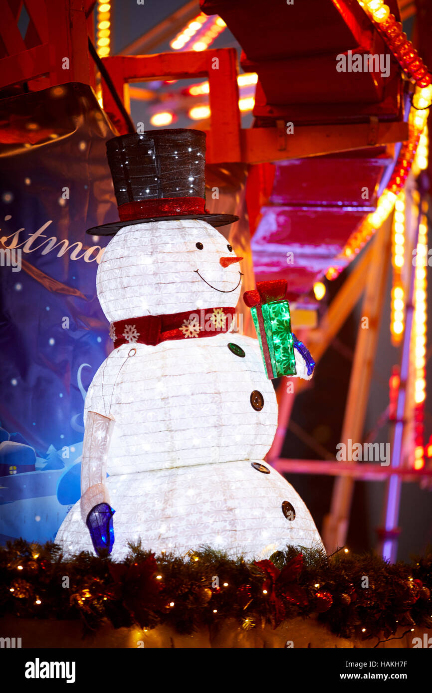 Manchester christmas fair snowman   Paper lamp light illuminated caricature Christmas winter festive festival Christian - Stock Image