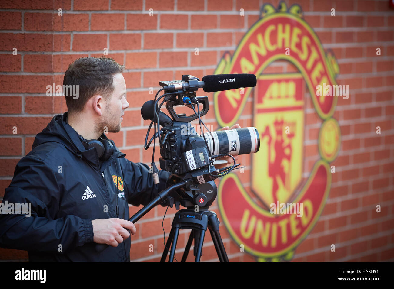 MUFC TV Manchester United filming   in house tv station MUTV filming in Stadium Sporting sports logo managers dugout - Stock Image