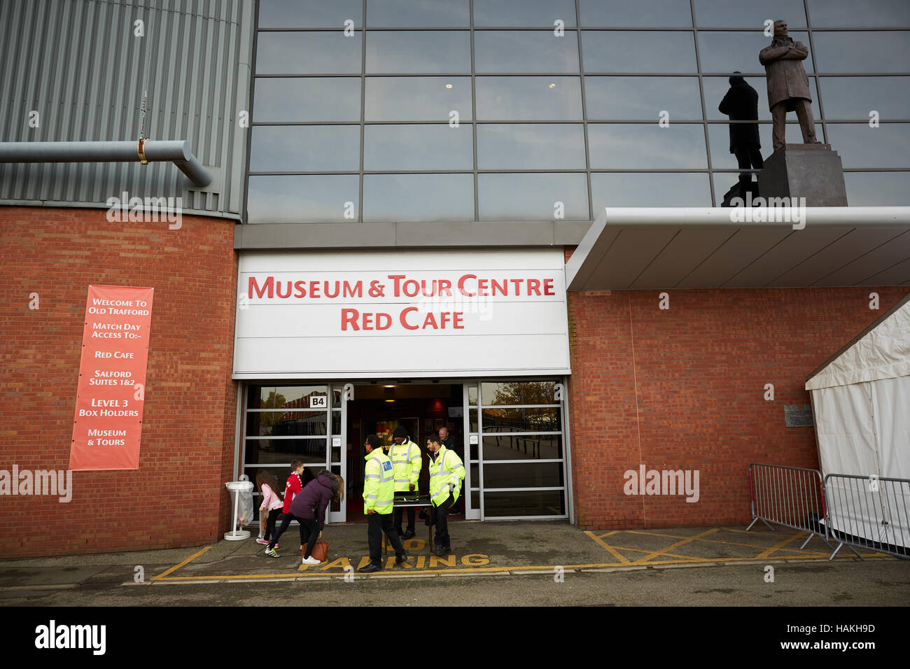 manchester united tour entrance red cafe security outside searching stock photo alamy https www alamy com stock photo manchester united tour entrance red cafe security outside searching 127049817 html