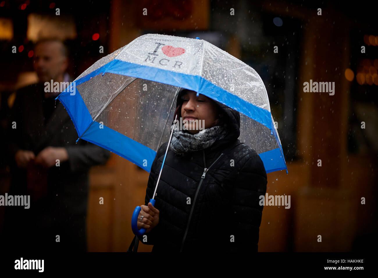 Manchester christmas markets rain  I love MCR umbrella up used street again lady damp - Stock Image
