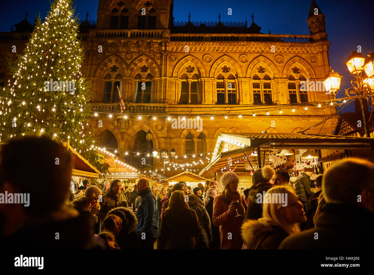 Chester German Christmas markets   Town hall exterior Christmas xmas festive seasonal market stalls gift  Market - Stock Image