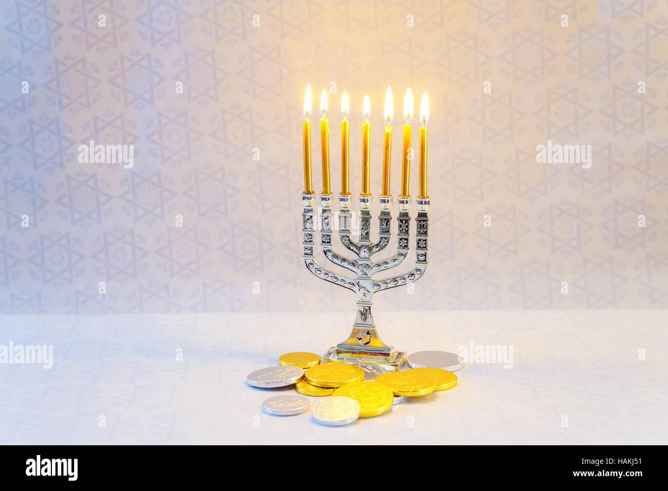 Jewish holiday hannukah symbols - menorah, donuts, chocolate coins and wooden dreidels jewish holiday Hanukkah with - Stock Image