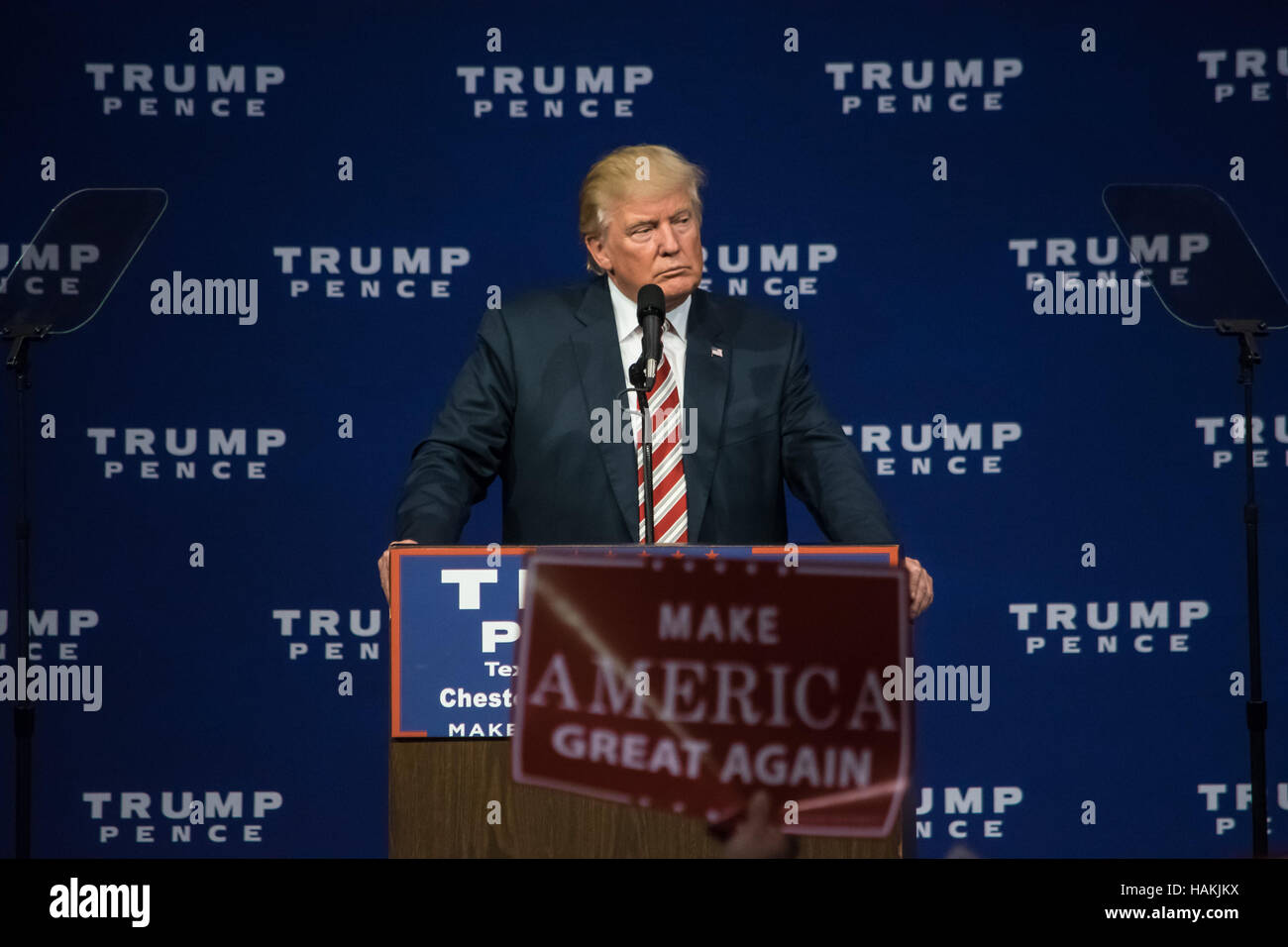 Republican Presidential Nominee Donald Trump pausing on stage during his campaign speech. - Stock Image