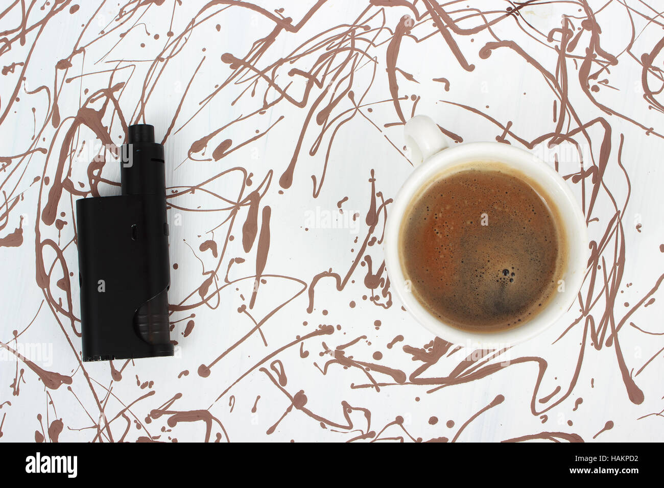 Vaping set and coffee - Stock Image