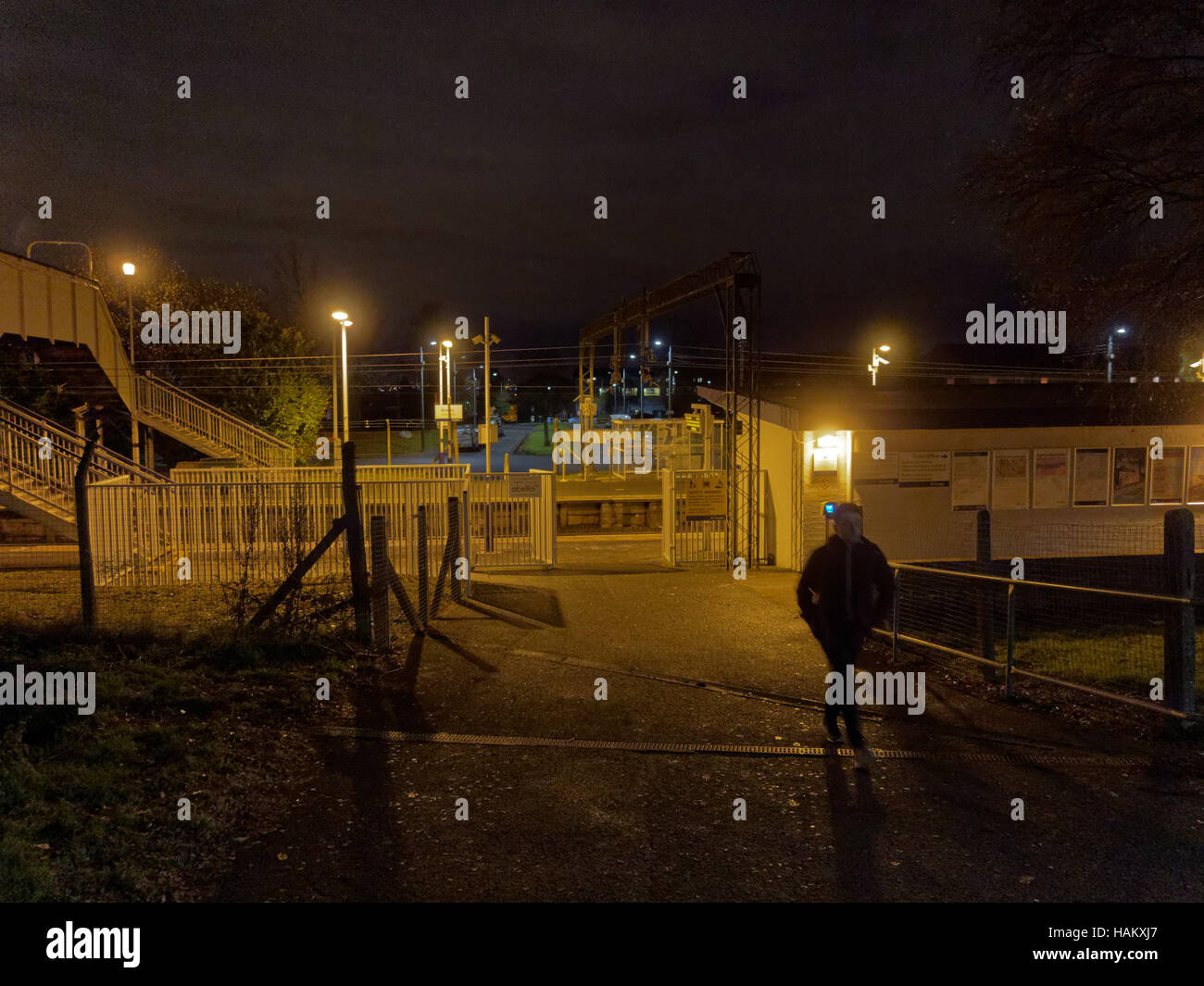 drumry railway station scotrail at night Lone person in the dark - Stock Image