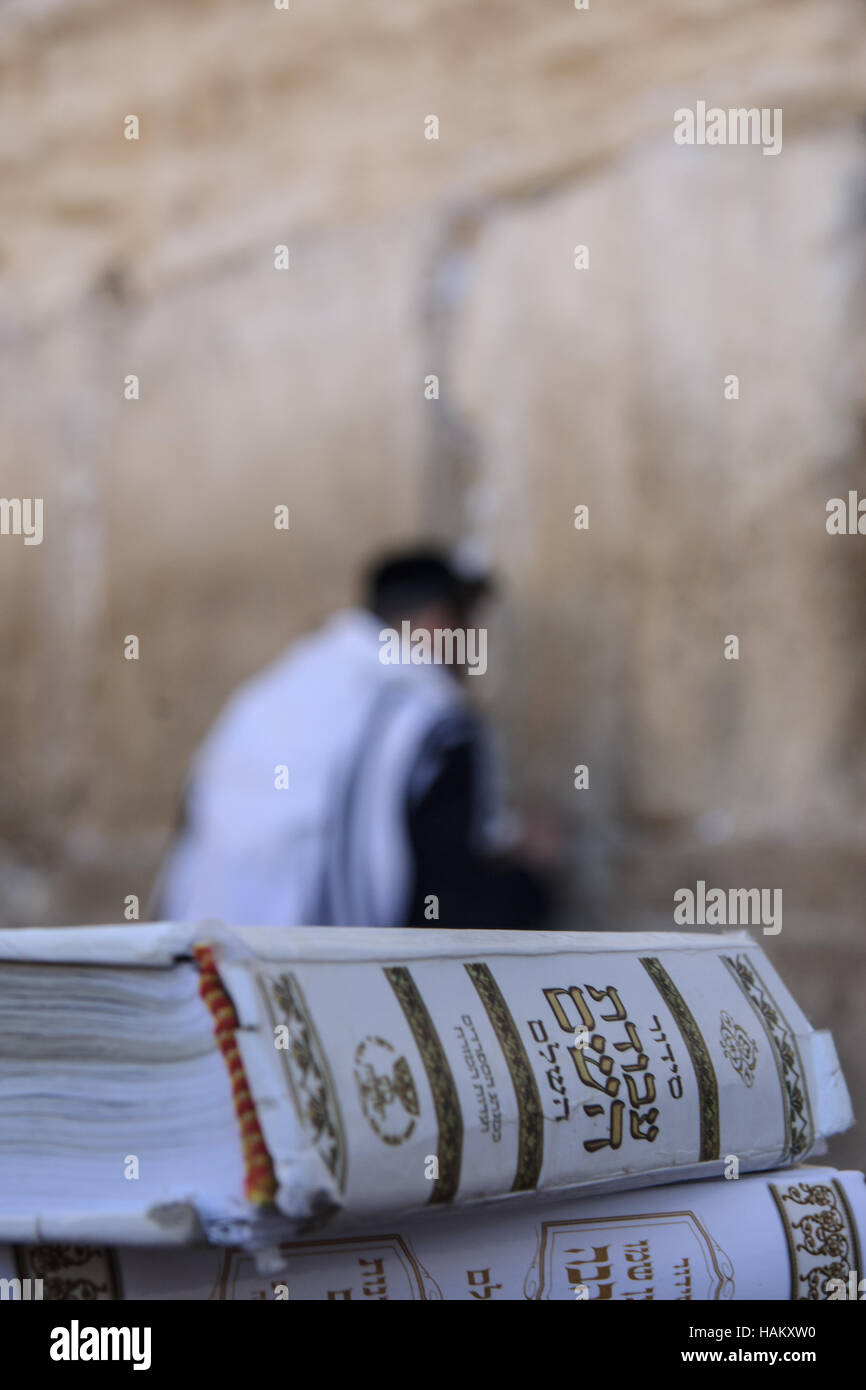 JERUSALEM - JULY 31 - Orthodox Jews prays at the Western Wall, behind praying book (Siddur) - July 31, 2013 in the - Stock Image
