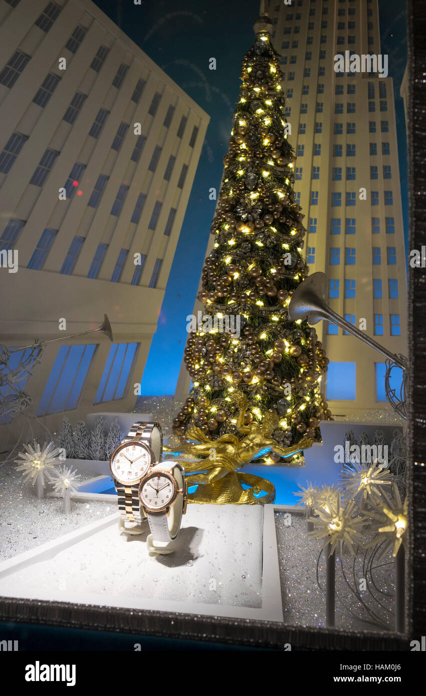 Christmas tree and wrist watches in Tiffany & Co. window display on Fifth Avenue in New York City - Stock Image