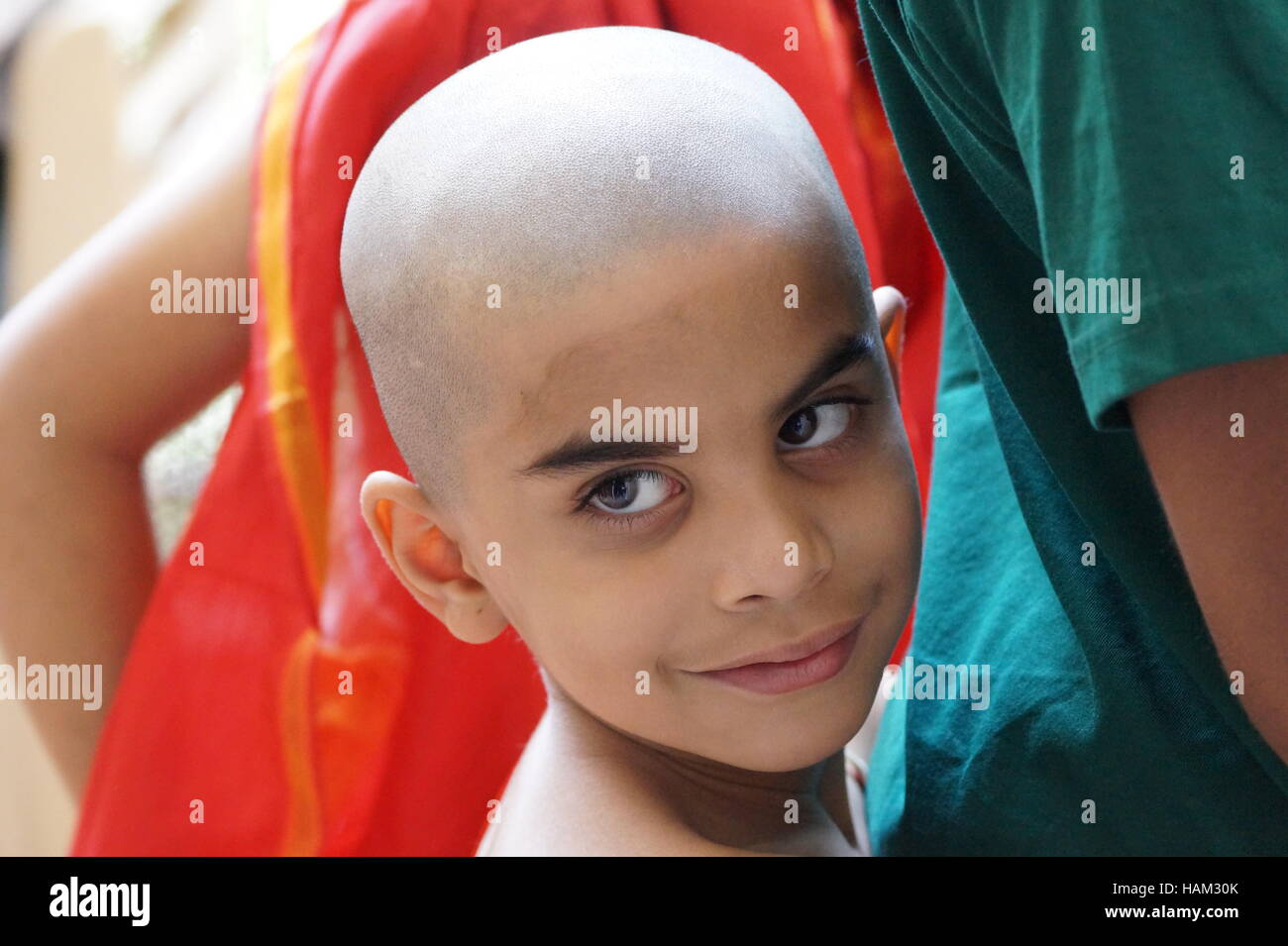 A candid photo,Indian boy after rituals,A cute India boy,Eyes speaks,Indian boy,Buddhist,Upanayan sanskar,Indian - Stock Image
