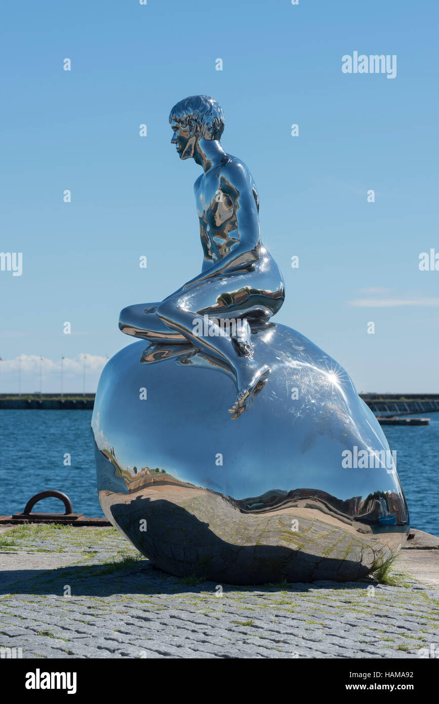 Sculpture of little merman Han, by artists Elmgreen and Dragset, at Cultural Harbour Kronborg in Elsinore, Denmark - Stock Image