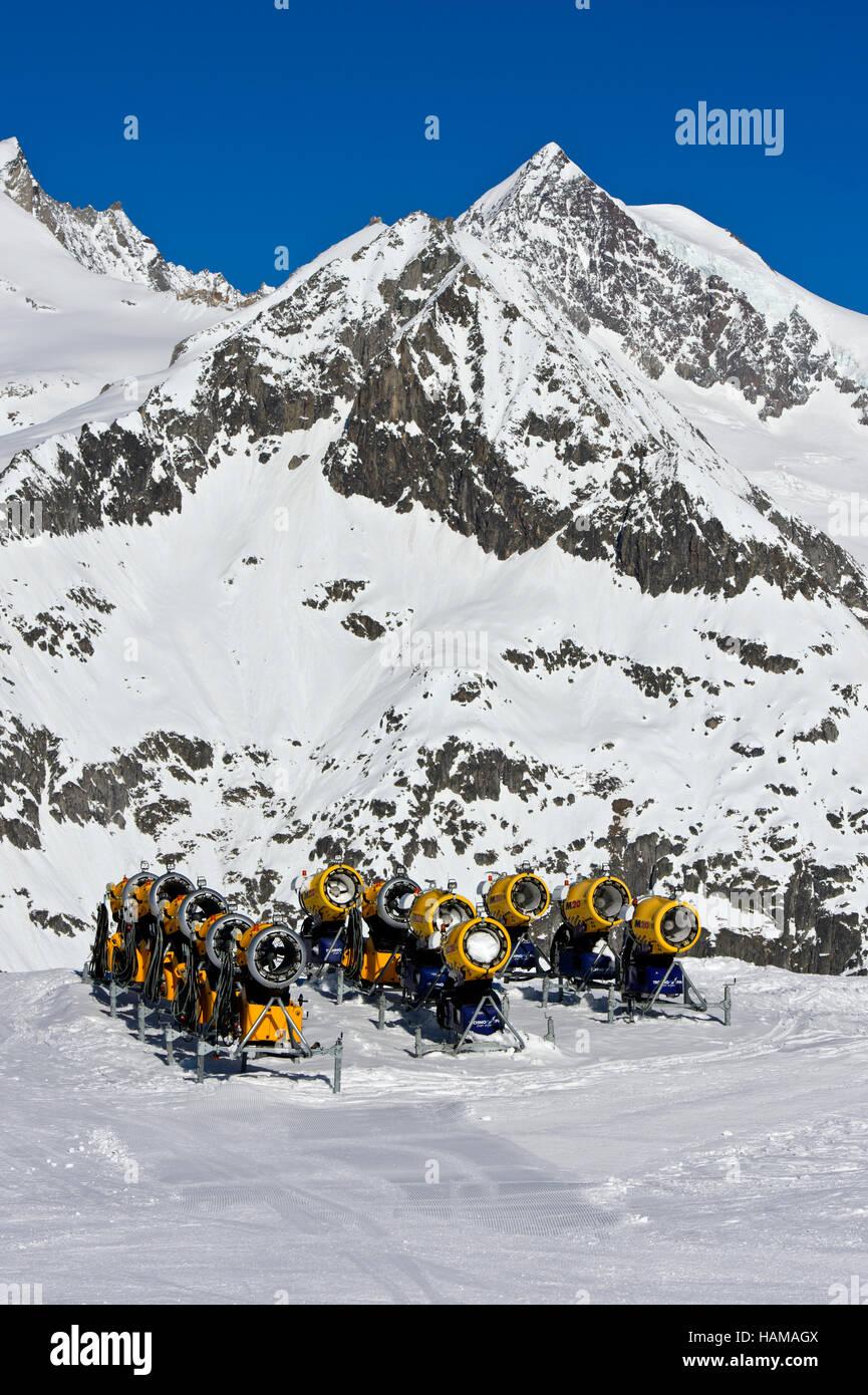 Snow cannons on ski slope, Aletsch Arena ski resort, Bettmeralp, Valais Canton, Switzerland - Stock Image