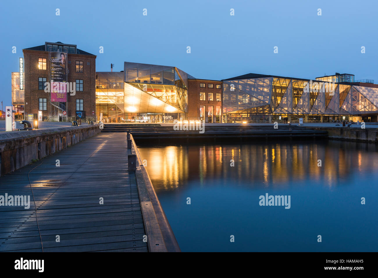 View at dusk of The Culture Yard, a modern cultural center with library, designed by AART architects in Elsinore - Stock Image