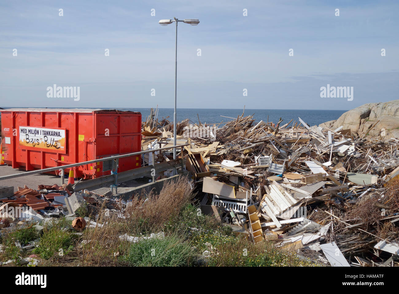 Dumping ground for discarded wood on the coast of Öckerö island, Bohuslan, Sweden Stock Photo