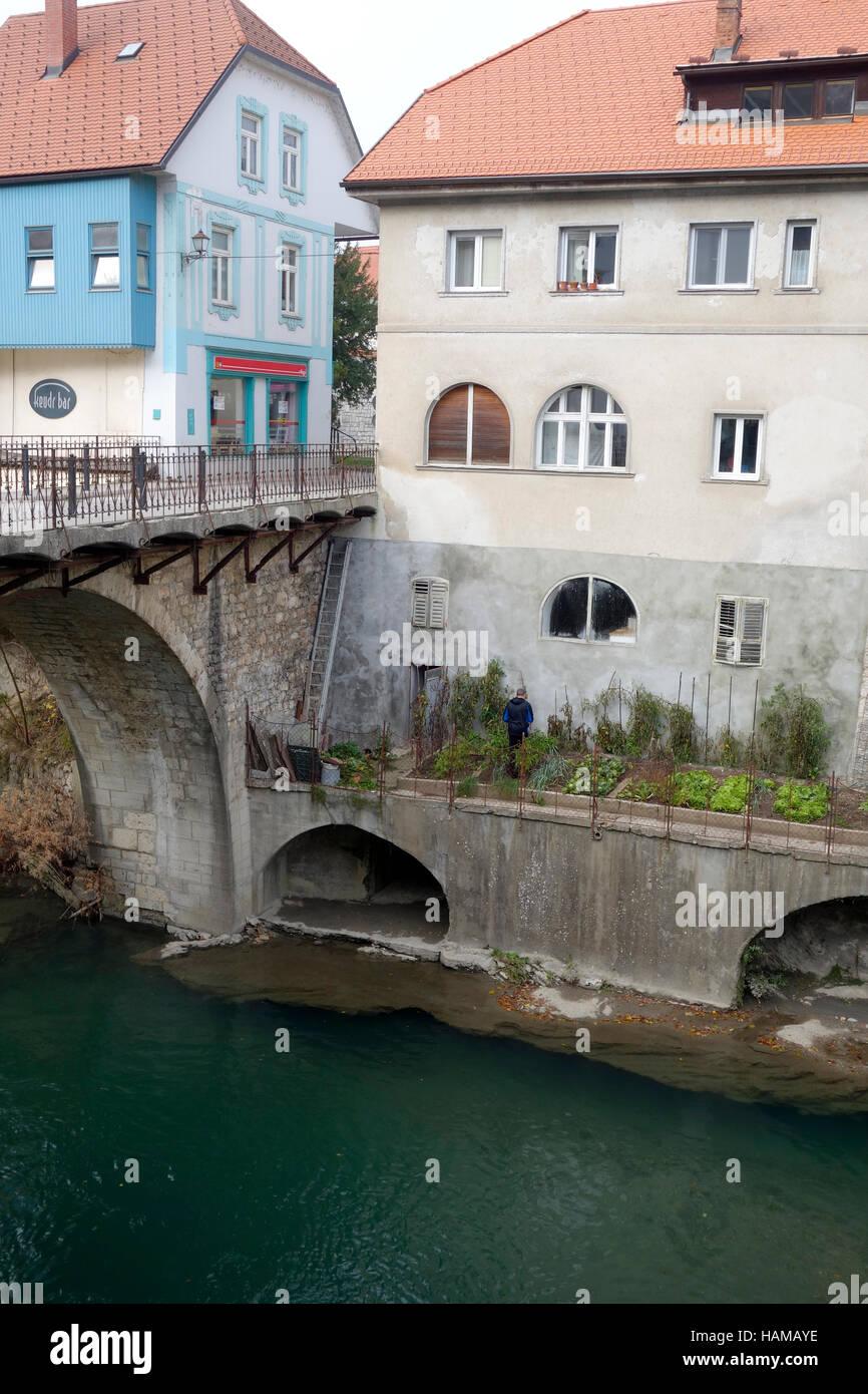 Kitchen garden on the bank of Selca Sora river, Capuchin bridge, Skofja Loka, Slovenia - Stock Image
