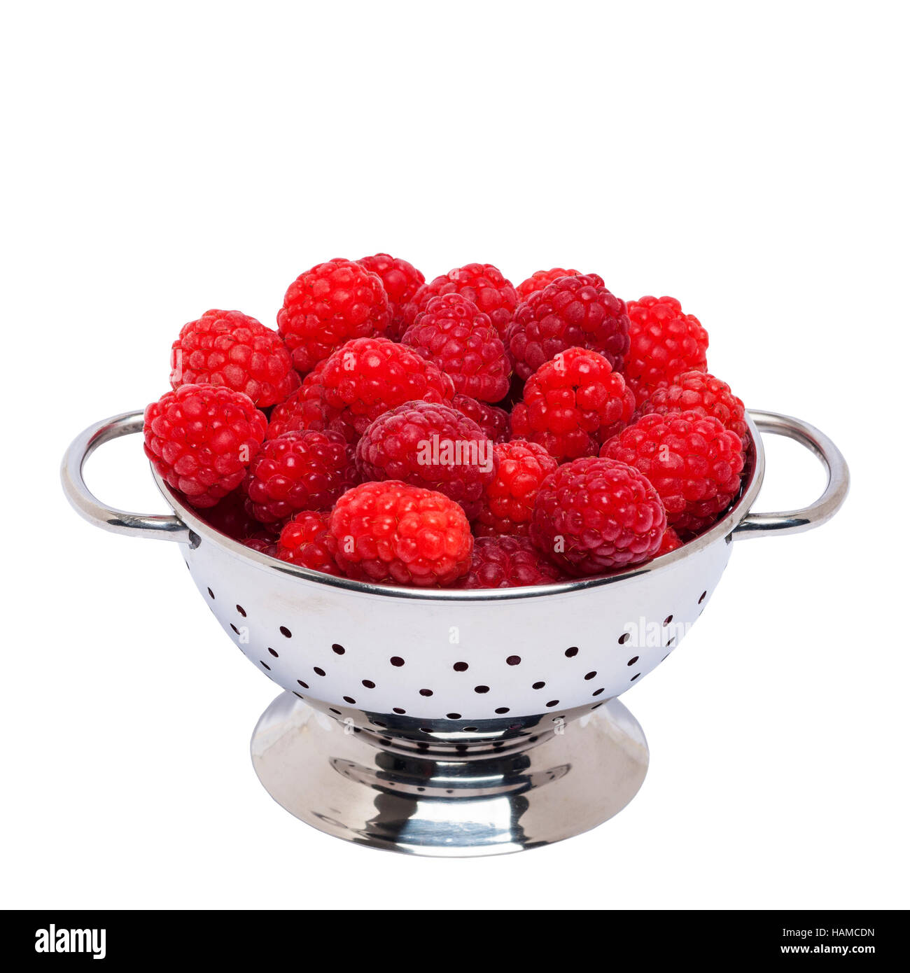 Fresh raspberries on a white background - Stock Image