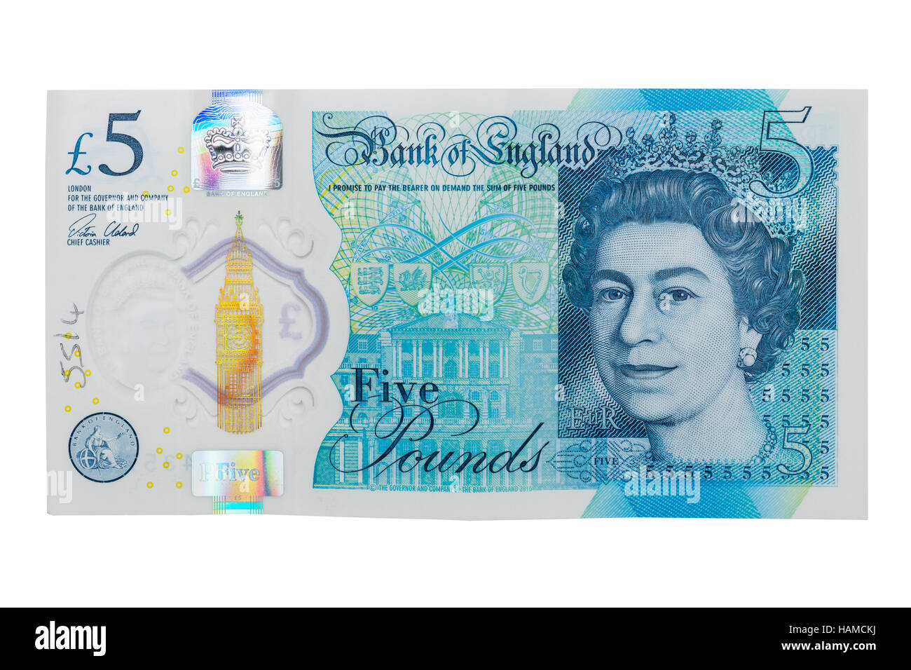 A new plastic £5 note on a white background - Stock Image