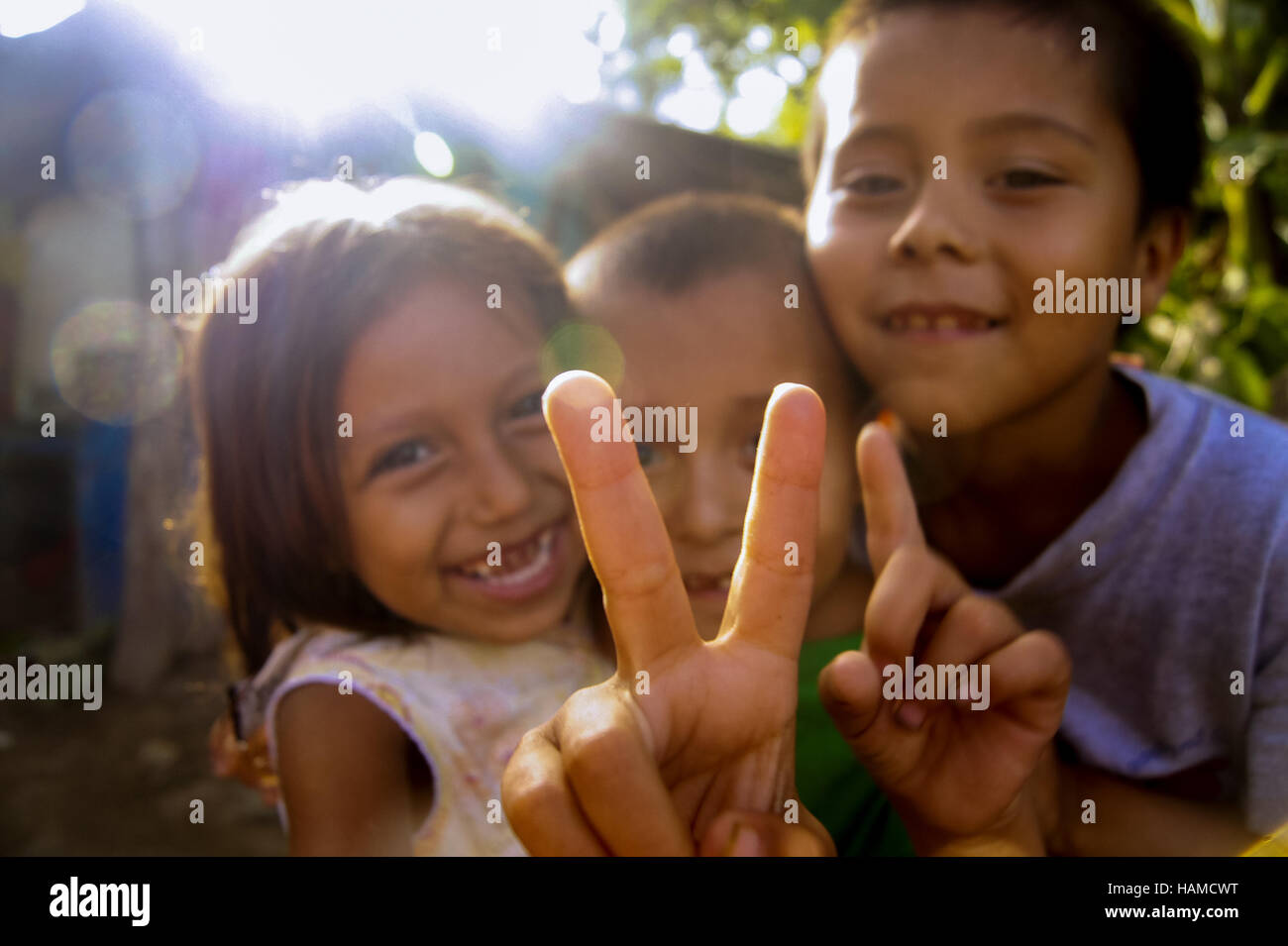 Honduras:  Playful, happy children giving the Peace sign. - Stock Image