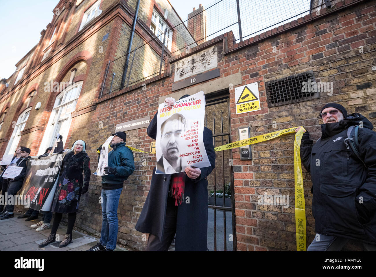 London, UK. 30th November, 2016. Anti-capitalist group Class War and other protesters outside the London offices - Stock Image