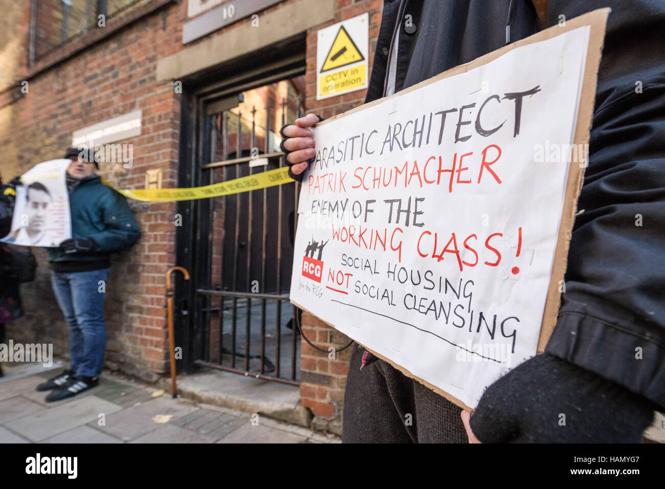London, UK. 30th November, 2016. Anti-capitalist group Class War and other protesters outside the London offices Stock Photo