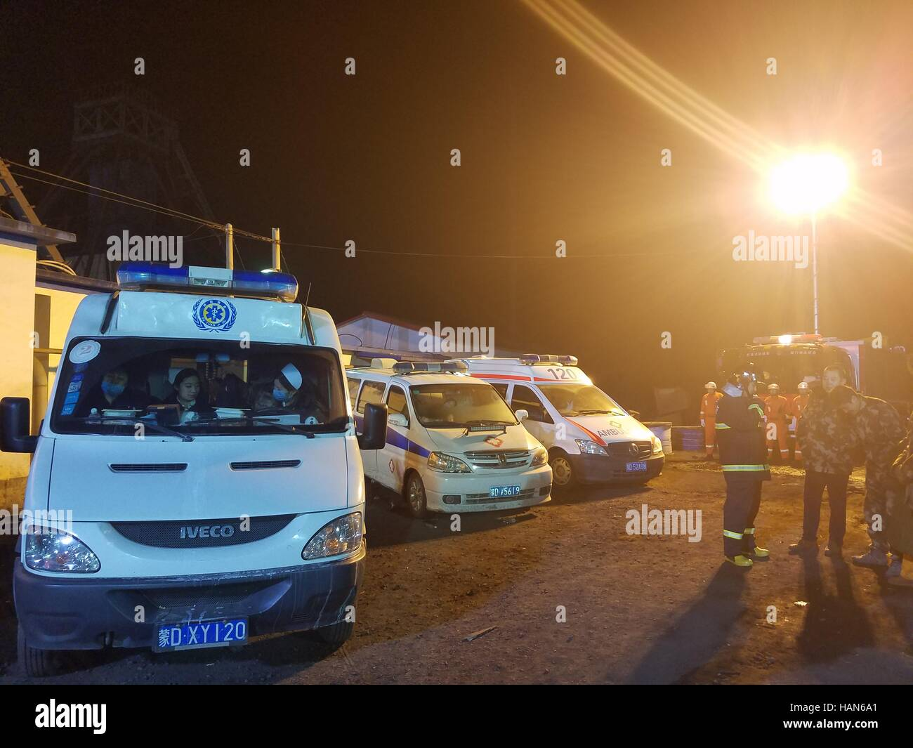 Chifeng. 3rd Dec, 2016. Photo taken by mobilephone shows rescuers and vehicles at the site of a coal mine accident - Stock Image